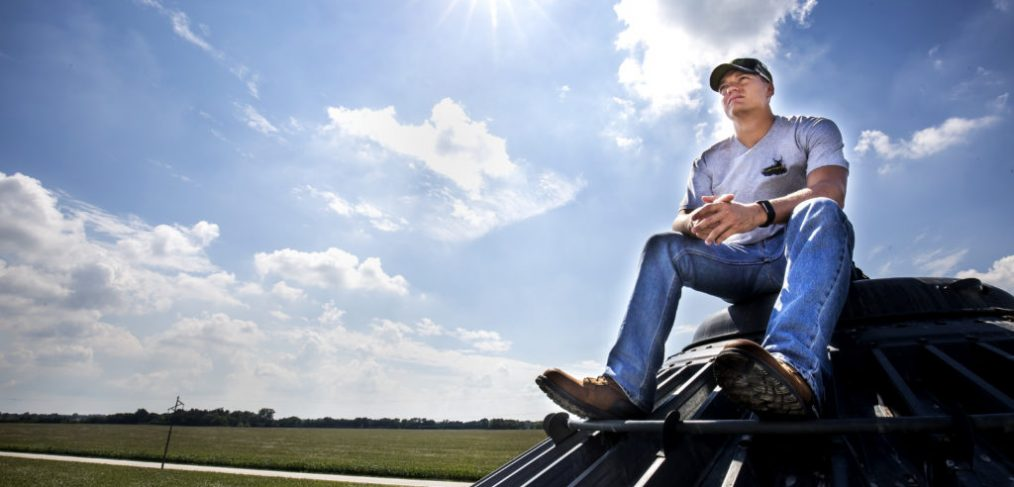 Kenneth sits on top of the 30,000 bushel grain bin on Engeling Farms property [Photo by J. Xu]